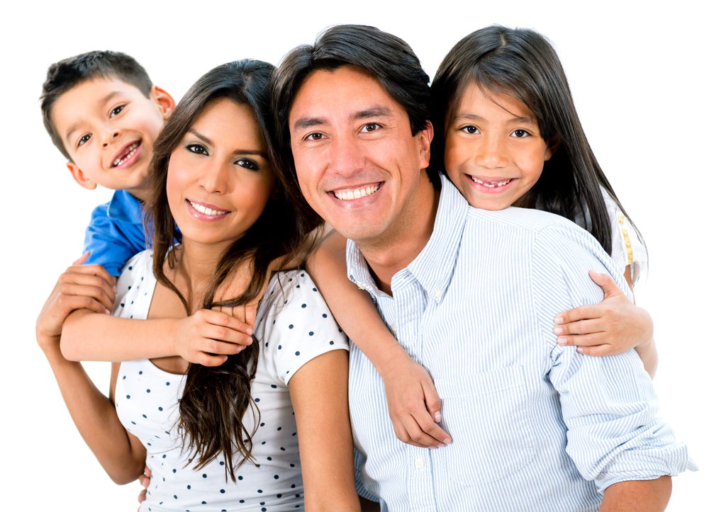Happy family portrait smiling together - isolated over white background